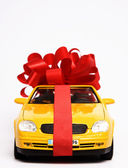 Luxury present wrapped in red ribbon — Stock Photo