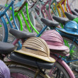 Stock Photo: Traditional Indonesibicylces with colonial helmets in Jakarta, Indonesia