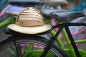 Traditional Indonesian bicylces with colonial helmets in Jakarta, Indonesia — Stock Photo