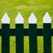 Stock Photo: Green and white picket fence