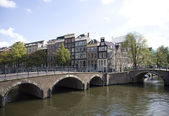Canal junction in Amsterdam, Holland — Stockfoto