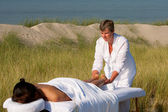 Massage in the dunes on the island Ameland, the Netherlands — Stock Photo