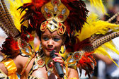 Carnival dancer at the Caribbean Carnival street parade — Stock Photo