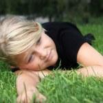 Girl lying in grass — Stock Photo