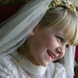 Girl in Holy Communion dress — Stock Photo