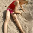 Girl drawing in the sand — Stock Photo
