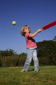 Girl playing rounders — Stock Photo