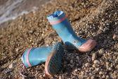 Boots left on beach — Stock Photo