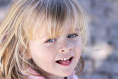 Portrait of a little girl with blue eyes — Stock Photo