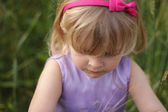 Blond toddler with pink hairband — Stock Photo