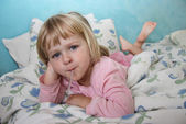 Sick girl in bed — Stock Photo