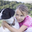 Girl with dog — Stock Photo #19044967