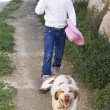 Girl walking dog — Stock Photo