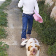 Girl walking dog — Stock Photo #19046485