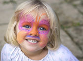 Little girl with face paint — ストック写真