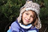 Girl wearing fur hat — Stock Photo