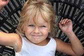 Girl on swing — Stock Photo