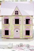 Dollhouse and teaset — Stock Photo