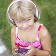 Child with smartphone and headphones — Stock Photo