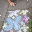 Stock Photo: Chalk drawing of butterflies on sidewalk