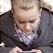 Young girl on cell phone — Stock Photo