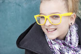 Smiling girl with glasses — Stock Photo
