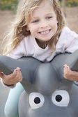 Girl smiling at the playground — Stock Photo