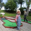 Children playing mini golf — Stock Photo #23854533