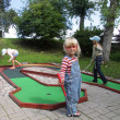 Children playing mini golf - Stock Photo