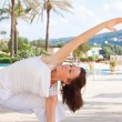 Senior woman doing yoga - Stock Photo