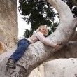Stock Photo: Child climbing tree