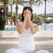 Woman meditating in lotus yoga — Stock Photo