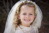 Girl in holy communion dress and veil — Stock Photo