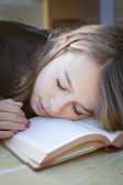 Student sleeping over book — Stock Photo