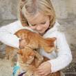 Child with kittens — Foto Stock