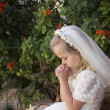Praying girl first holy communion — Stock Photo