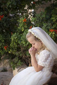 Praying girl first holy communion — Stock fotografie