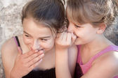 Girls whispering secrets — Stock Photo