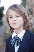 Dziecko w mundurek szkolny — Zdjęcie stockowe