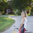 Child on bicycle on country road — Stock Photo