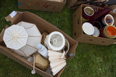 Boxes on yard sale — Stock Photo