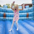 Child in bouncing castle — Stock Photo