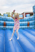 Child in bouncing castle — Stock fotografie