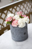 Pink carnations on table — Stock Photo