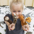 Child with finger puppets — Stock Photo