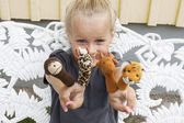 Child with finger puppets — ストック写真