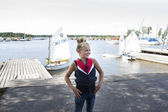 Girl with sailing boats — Stock Photo