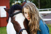 Teenager and icelandic horse — Stock Photo