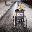 Lonely child in wheelchair — Stock Photo