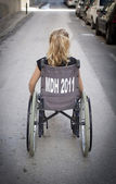 Child alone in wheelchair — Stock Photo